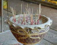 Incense burner. Incense sticks burning in a temple area at Ayutthaya in Thailand royalty free stock image