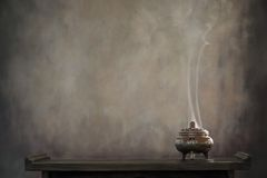 Incense burner on table. Religious concept stock image