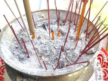 Incense burner In thai Temple. Temple buddhist is burning incense sticks Royalty Free Stock Photos