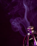 Incense Burning. Pretty incense burner with smoke coming out of it stock photos