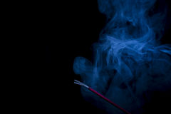 Incense burning with blue smoke Royalty Free Stock Photography