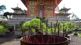 Incense burning in a Buddhist temple stock video footage