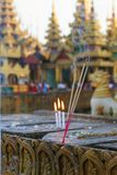 Incense and burning candles. Incense sticks and burning candles near a pagoda in Burma Royalty Free Stock Image