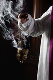 Incense burning in church. Church incense burner held by a catholic priest stock images