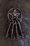 Incense burning in gray metal pentagram with love keyring on sla Stock Images