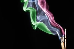 Incense burning over black background detail royalty free stock image