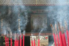 Incense burning in a temple Royalty Free Stock Photos