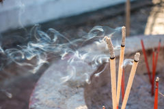 Incense burning. In a temple Stock Images