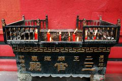 Incense and candle burner in a temple Stock Image