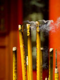 Incense and candle in temple Stock Photo