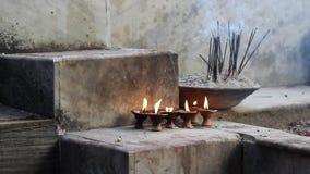 Incense and candles (medium shot)