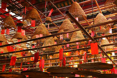 Incense coils in Man Mo Temple. Hong Kong. HONG KONG - August 30, 2016: Smoke from the burning incense coils. Man Mo Temple was build in 1847-1862 bij chinese Stock Photography