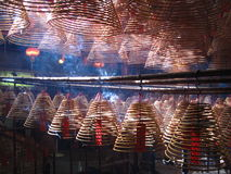 Incense Coils in Man Mo temple, Hong Kong. Stock Photos