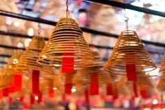Incense coils and wishes at Man Mo Temple, Hong Kong. Incense coils with wishes in Man Mo Temple, Hong Kong. Shallow DOF Stock Image