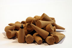 Incense cones 2. A pile of incense cones with one burning stock image