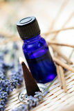 Incense cones and aromatherapy oil. Incense cones with aromatherapy oil and lavender flowers - aromatherapy Royalty Free Stock Photography