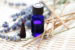 Incense cones and aromatherapy oil. Incense cones with aromatherapy oil and lavender flowers - aromatherapy Stock Photography