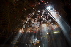 Incense and crepuscular rays in Man mo temple Stock Images