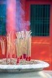 Incense furnace and smoking joss stick Royalty Free Stock Photos