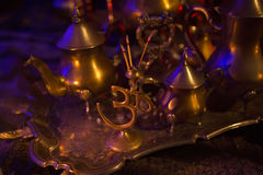 Incense in a Golden stand of Om symbol form and Luxurious gold Royalty Free Stock Images