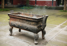 Incense holder in Buddhist temple Royalty Free Stock Images