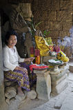 Incense and lucky charm seller in angkor wat temple cambodia Royalty Free Stock Photo
