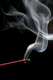 Incense over black. Incense stick with smoke trail shot over black Royalty Free Stock Photos
