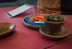 Incense in pottery for the offering on top of red table photo taken in Batik Museum Pekalongan Indonesia Stock Image