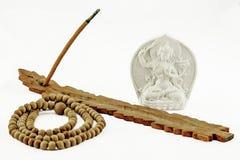 Incense, prayer beads and Buddha Stock Photo