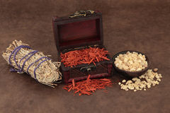 Incense Selection. Frankincense, sandalwood and sage smudge stick incense selection over lokta paper background Stock Photography