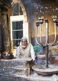 Incense-seller in a muslim shrine in New Delhi Stock Image