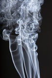 Incense smoke. Dynamic incense smoke on black background royalty free stock photos
