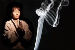 Incense smoke and Asian woman. Stock Images