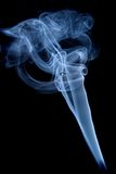 Incense smoke II. Sinuous blue incense smoke on a black background Stock Images