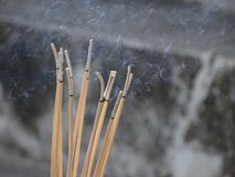 Incense smoke set form to the air royalty free stock photos