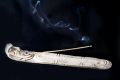 Incense smoke spiritual. Incense burner with smoke with a black background Stock Image