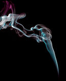 Incense smoke trails. An incense stick making smoke trails in beautiful designs Royalty Free Stock Photos