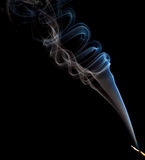 Incense smoke trails. An incense stick making smoke trails in beautiful designs Stock Photography