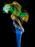 Incense smoke trails. Colorized incense smoke trails on a black background royalty free stock images