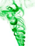 Incense smoke trails. Colorized incense smoke trails on a white background royalty free stock image