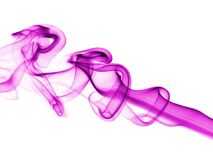 Incense smoke trails. Colorized incense smoke trails on a white background royalty free stock photography