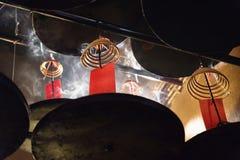 Incense spirals burning at the ceiling of Man Mo temple, Hong Kong, Asia Royalty Free Stock Image
