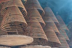 Incense spirals in a temple royalty free stock photography