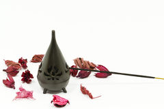 Incense stick. In burner with red flower leaves Royalty Free Stock Photography