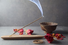 Incense stick. Aromatherapy. Whit petals Royalty Free Stock Image