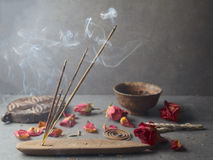 Incense stick. Aromatherapy. Whit petals Stock Image