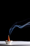 An incense stick burning Stock Photo