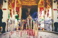 Incense stick burning,Thai Buddhists use incense to worship Budd. Ha, Scenery background of the incense and faithful Royalty Free Stock Photo