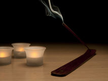 Incense stick with candles. Incense stick burning with four candles and dark background Stock Photo
