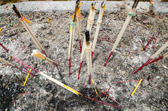 Incense stick and candles. The candles were burning in the basin soil Stock Image